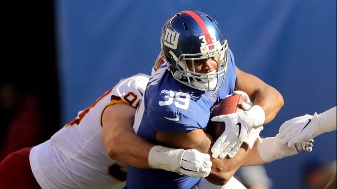 EAST RUTHERFORD, NEW JERSEY - SEPTEMBER 29: Elijhaa Penny #39 of the New York Giants carries the ball as Matthew Ioannidis #98 of the Washington Redskins defends in the fourth quarter at MetLife Stadium on September 29, 2019 in East Rutherford, New Jersey.