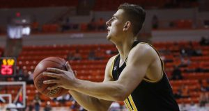 Wichita State guard Erik Stevenson shoots in the second half of an NCAA college basketball game against Oklahoma State in Stillwater, Okla., Sunday, Dec. 8, 2019.