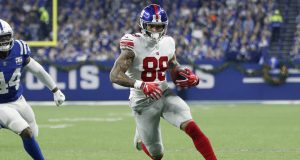 INDIANAPOLIS, INDIANA - DECEMBER 23: Evan Engram #88 of the New York Giants runs the ball in the game against the Indianapolis Colts in the first quarter at Lucas Oil Stadium on December 23, 2018 in Indianapolis, Indiana.
