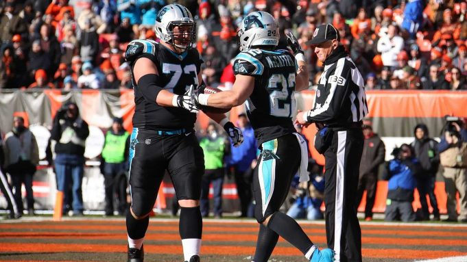 CLEVELAND, OH - DECEMBER 09: Christian McCaffrey #22 of the Carolina Panthers celebrates his touchdown with Greg Van Roten #73 during the first quarter against the Cleveland Browns at FirstEnergy Stadium on December 9, 2018 in Cleveland, Ohio. New York Jets
