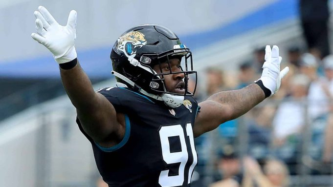 JACKSONVILLE, FLORIDA - DECEMBER 02: Yannick Ngakoue #91 of the Jacksonville Jaguars celebrates a defensive stop during the game against the Indianapolis Colts on December 02, 2018 in Jacksonville, Florida.