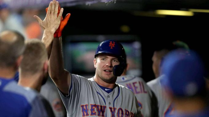 DENVER, COLORADO - SEPTEMBER 17: Pete Alonso #20 of the New York Mets is congratulated in the dugout after hitting a solo home run in the sixth inning against the Colorado Rockies at Coors Field on September 17, 2019 in Denver, Colorado.