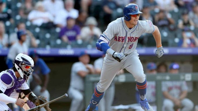 DENVER, COLORADO - SEPTEMBER 18: Brandon Nimmo #9 of the New York Mets hits a RBI single in the ninth inning against the Colorado Rockies at Coors Field on September 18, 2019 in Denver, Colorado.