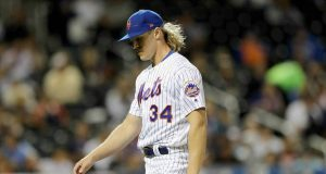 NEW YORK, NEW YORK - SEPTEMBER 24: Noah Syndergaard #34 of the New York Mets walks off the field after the fifth inning against the Miami Marlins at Citi Field on September 24, 2019 in the Flushing neighborhood of the Queens borough of New York City.