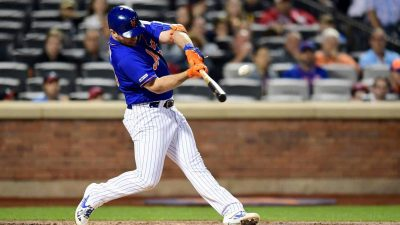 NEW YORK, NEW YORK - SEPTEMBER 27: Pete Alonso #20 of the New York Mets hits a home run in the first inning of their game against the Atlanta Braves, his 52nd home run of the season and tying Aaron Judge's rookie home run record, during their game at Citi Field on September 27, 2019 in the Flushing neighborhood of the Queens borough of New York City.