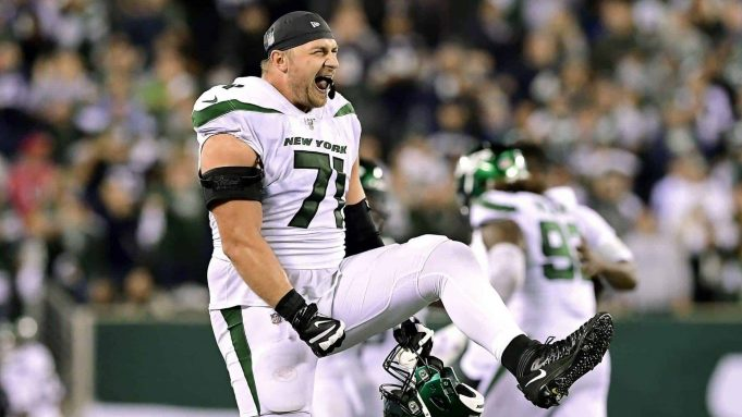 EAST RUTHERFORD, NEW JERSEY - OCTOBER 13: Alex Lewis #71 of the New York Jets celebrates after a failed two-point attempt by the Dallas Cowboys in the final minute of the fourth quarter at MetLife Stadium on October 13, 2019 in East Rutherford, New Jersey.