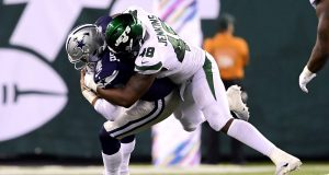 EAST RUTHERFORD, NEW JERSEY - OCTOBER 13: Dak Prescott #4 of the Dallas Cowboys is sacked by Jordan Jenkins #48 of the New York Jets during the fourth quarter at MetLife Stadium on October 13, 2019 in East Rutherford, New Jersey.