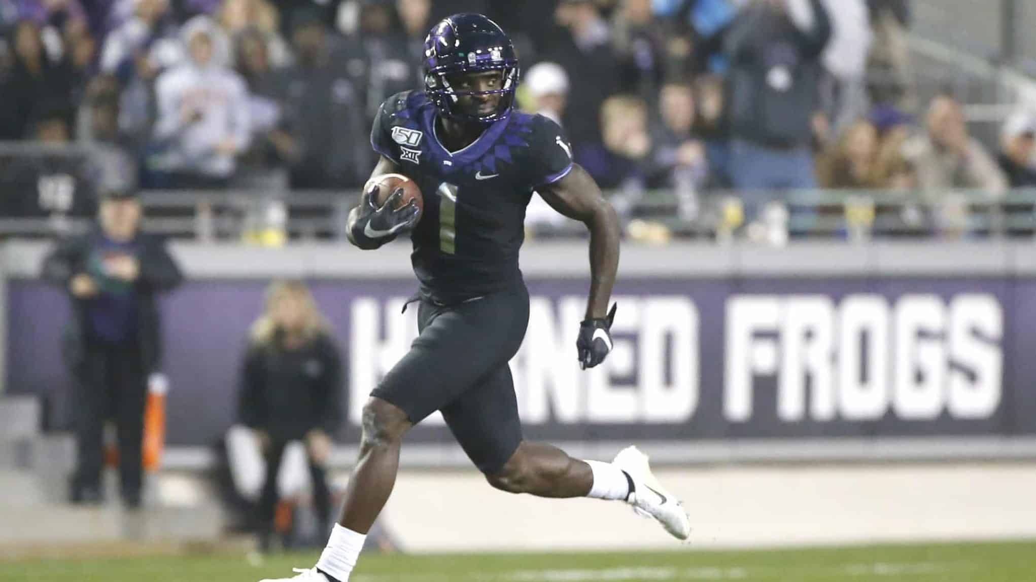 FORT WORTH, TX - NOVEMBER 29: Jalen Reagor #1 of the TCU Horned Frogs returns a punt for a touchdown against the West Virginia Mountaineers in the second half at Amon G. Carter Stadium on November 29, 2019 in Fort Worth, Texas. West Virginia won 20-17.