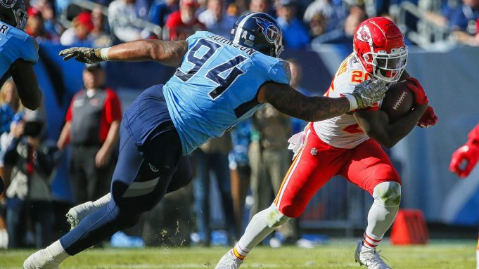 NASHVILLE, TENNESSEE - NOVEMBER 10: Damien Williams #26 of the Kansas City Chiefs rushes past Austin Johnson #94 of the Tennessee Titans during the first half at Nissan Stadium on November 10, 2019 in Nashville, Tennessee.