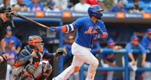 PORT ST. LUCIE, FL - MARCH 08: Robinson Cano #24 of the New York Mets hits an RBI double against the Houston Astros during the fifth inning of a spring training baseball game at Clover Park on March 8, 2020 in Port St. Lucie, Florida. The Mets defeated the Astros 3-1.