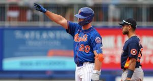 PORT ST. LUCIE, FL - MARCH 08: Pete Alonso #20 of the New York Mets gestures after he hit an RBI double against the Houston Astros during the fifth inning of a spring training baseball game at Clover Park on March 8, 2020 in Port St. Lucie, Florida. The Mets defeated the Astros 3-1.
