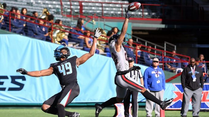ARLINGTON, TEXAS - MARCH 07: Dravon Askew-Henry #22 of the New York Guardians breaks up a pass intended for Donald Parham #49 of the Dallas Renegades at an XFL football game against the Dallas Renegades on March 07, 2020 in Arlington, Texas.