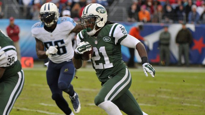 NASHVILLE, TN - DECEMBER 14: Chris Johnson #21 of the New York Jets rushes against the Tennessee Titans during the second half of a game at LP Field on December 14, 2014 in Nashville, Tennessee.