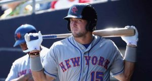 PEORIA, AZ - OCTOBER 13: Tim Tebow #15 (New York Mets) of the Scottsdale Scorpions warms up in the dugout during the Arizona Fall League game against the Peoria Javelinas at Peoria Stadium on October 13, 2016 in Peoria, Arizona.