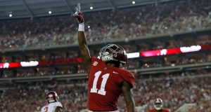 TUSCALOOSA, AL - OCTOBER 14: Henry Ruggs III #11 of the Alabama Crimson Tide reacts after pulling in a touchdown reception against the Arkansas Razorbacks at Bryant-Denny Stadium on October 14, 2017 in Tuscaloosa, Alabama. Potential New York Jets draft pick