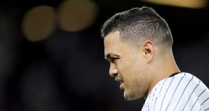 NEW YORK, NEW YORK - OCTOBER 04: Giancarlo Stanton #27 of the New York Yankees reacts after grounding out against the Minnesota Twins during the first inning in game one of the American League Division Series at Yankee Stadium on October 04, 2019 in New York City.