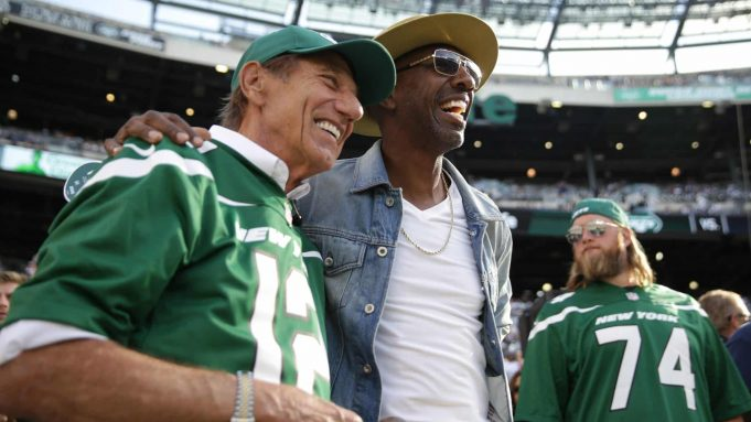 EAST RUTHERFORD, NEW JERSEY - OCTOBER 13: Hall of Famer Joe Namath and J. B. Smoove pose for pictures before the game between the New York Jets and the Dallas Cowboys at MetLife Stadium on October 13, 2019 in East Rutherford, New Jersey.