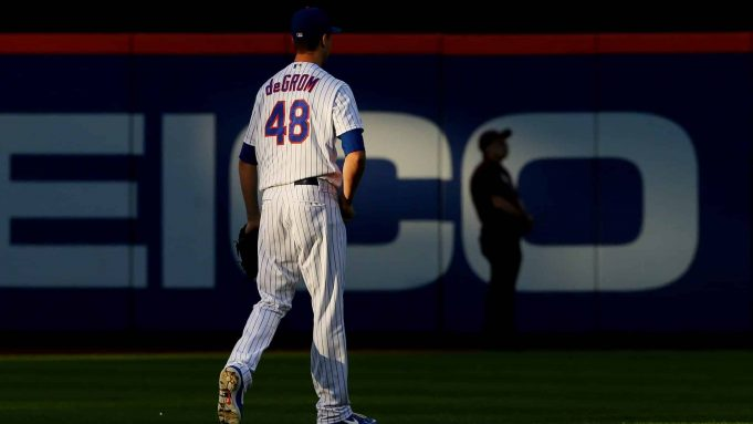 NEW YORK, NY - AUGUST 29: Pitcher Jacob deGrom #48 of the New York Mets walks out to the bullpen before his start against the Chicago Cubs at Citi Field on August 29, 2019 in New York City. The Cubs defeated the Mets 4-1.