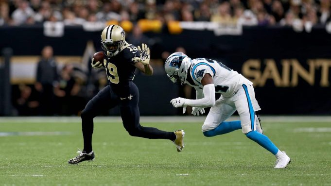 NEW ORLEANS, LOUISIANA - NOVEMBER 24: Ted Ginn #19 of the New Orleans Saints breaks a tackle against James Bradberry #24 of the Carolina Panthers during the first quarter in the game at Mercedes Benz Superdome on November 24, 2019 in New Orleans, Louisiana.