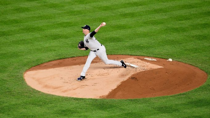 NEW YORK, NEW YORK - OCTOBER 18: James Paxton #65 of the New York Yankees throws a pitch against the Houston Astros during the first inning in game five of the American League Championship Series against the Houston Astros at Yankee Stadium on October 18, 2019 in New York City.