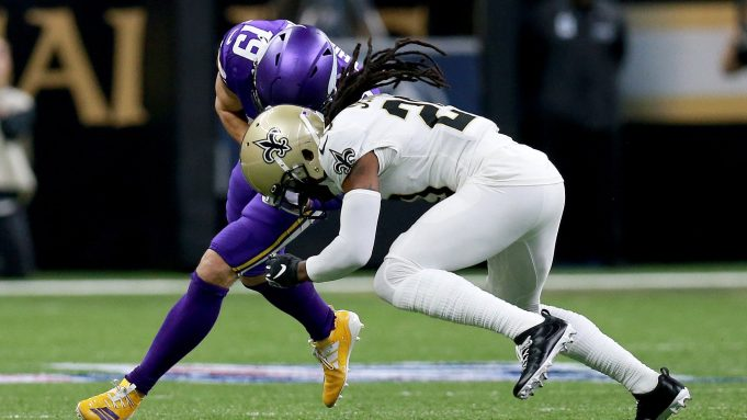 NEW ORLEANS, LOUISIANA - JANUARY 05: Janoris Jenkins #20 of the New Orleans Saints forces a fumble on Adam Thielen #19 of the Minnesota Vikings in the NFC Wild Card Playoff game at Mercedes Benz Superdome on January 05, 2020 in New Orleans, Louisiana.