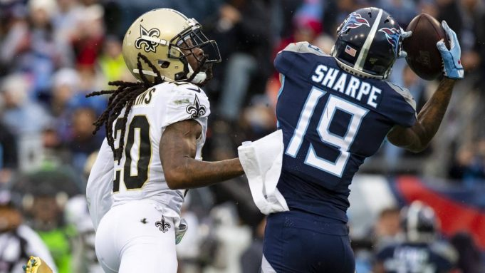NASHVILLE, TN - DECEMBER 22: Tajae Sharpe #19 of the Tennessee Titans makes a touchdown reception against Janoris Jenkins #20 of the New Orleans Saints during the fourth quarter at Nissan Stadium on December 22, 2019 in Nashville, Tennessee. New Orleans defeats Tennessee 38-28.