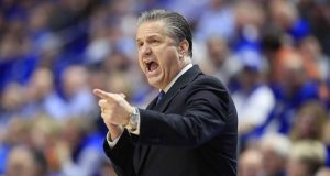 LEXINGTON, KENTUCKY - MARCH 03: John Calipari the head coach of the Kentucky Wildcats gives instructions to his team against the Tennessee Volunteers at Rupp Arena on March 03, 2020 in Lexington, Kentucky.
