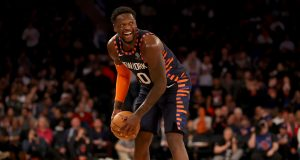 NEW YORK, NEW YORK - FEBRUARY 29: Julius Randle #30 of the New York Knicks smiles as he runs out the clock in the final minute of the game against the Chicago Bulls at Madison Square Garden on February 29, 2020 in New York City.The New York Knicks defeated the Chicago Bulls 125-115.NOTE TO USER: User expressly acknowledges and agrees that, by downloading and or using this photograph, User is consenting to the terms and conditions of the Getty Images License Agreement.