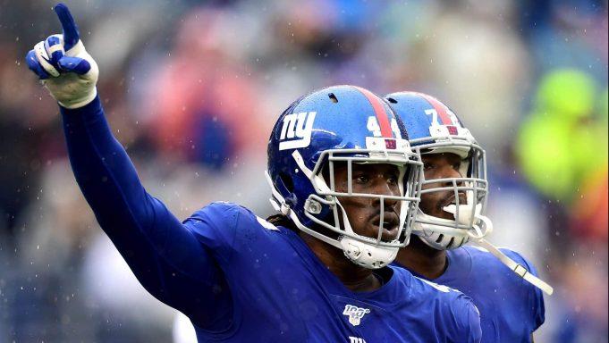 EAST RUTHERFORD, NEW JERSEY - OCTOBER 20: Markus Golden #44 and Olsen Pierre #72 of the New York Giants celebrate during the second quarter of their game against the Arizona Cardinals at MetLife Stadium on October 20, 2019 in East Rutherford, New Jersey.