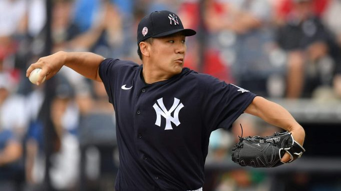 TAMPA, FLORIDA - FEBRUARY 26: Masahiro Tanaka #19 of the New York Yankees delivers a pitch in the second inning during the spring training game against the Washington Nationals at Steinbrenner Field on February 26, 2020 in Tampa, Florida.