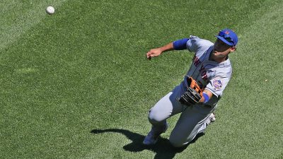 CHICAGO, ILLINOIS - AUGUST 01: Michael Conforto #30 of the New York Mets makes a sliding catch to end the 7th inning against the Chicago White Sox at Guaranteed Rate Field on August 01, 2019 in Chicago, Illinois.
