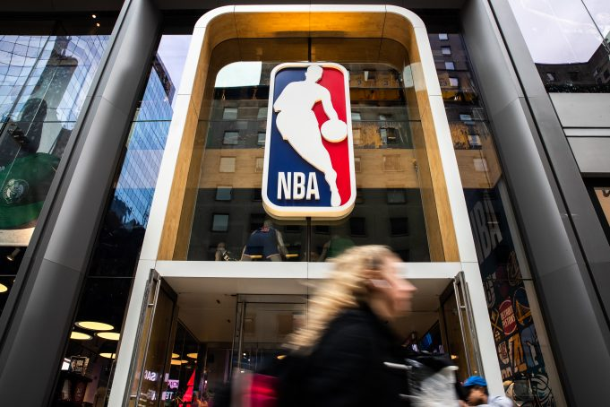 NEW YORK, NY - MARCH 12: A pedestrian walks past the NBA store on 5th Avenue on March 12, 2020 in New York City. The National Basketball Association said they would suspend all games after player Rudy Gobert of the Utah Jazz reportedly tested positive for the Coronavirus (COVID-19).