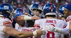 LANDOVER, MD - DECEMBER 22: Daniel Jones #8 of the New York Giants celebrates with teammates after throwing the game winning touchdown against the Washington Redskins during overtime at FedExField on December 22, 2019 in Landover, Maryland.