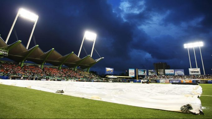 SAN JUAN, PUERTO RICO - JUNE 30: A tarp covers the field during a rain delay in the game between the New York Mets and the Florida Marlins at Hiram Bithorn Stadium on June 30, 2010 in San Juan, Puerto Rico.