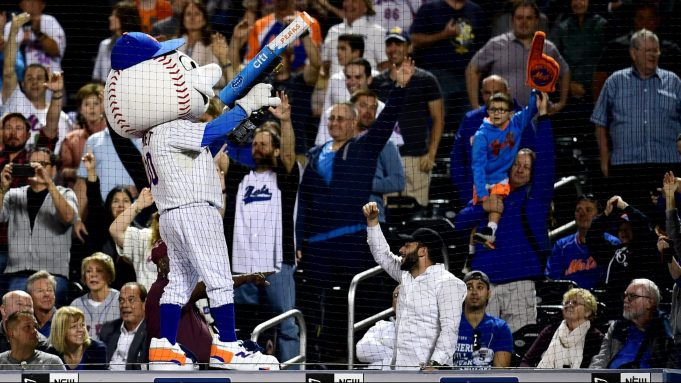 NEW YORK, NEW YORK - SEPTEMBER 24: Fans cheer as Mr. Met throws tee shirts during the New York Mets and Miami Marlins game at Citi Field on September 24, 2019 in the Flushing neighborhood of the Queens borough of New York City.