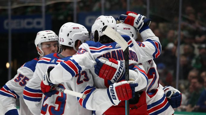 DALLAS, TEXAS - MARCH 10: The New York Rangers celebrate a goal by Kaapo Kakko #24 against the Dallas Stars during the second period at American Airlines Center on March 10, 2020 in Dallas, Texas.