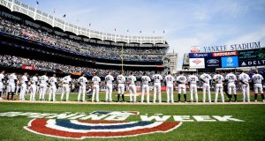 NEW YORK, NEW YORK - MARCH 28: The New York Yankees stand for the National Anthem before the game against the Baltimore Orioles on Opening Day at Yankee Stadium on March 28, 2019 in the Bronx borough of New York City.