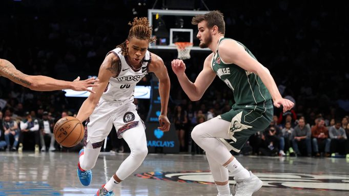 NEW YORK, NEW YORK - JANUARY 18: Nicolas Claxton #22 of the Brooklyn Nets dribbles against Dragan Bender #17 of the Milwaukee Bucks during their game at Barclays Center on January 18, 2020 in New York City. NOTE TO USER: User expressly acknowledges and agrees that, by downloading and/or using this photograph, user is consenting to the terms and conditions of the Getty Images License Agreement.