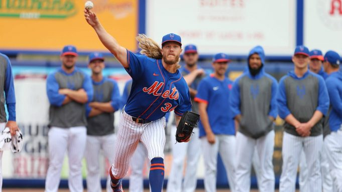 PORT ST. LUCIE, FL - MARCH 08: Pitcher Noah Syndergaard #34 of the New York Mets warms up in the bullpen in front of his fellow pitches before a spring training baseball game against the Houston Astros at Clover Park on March 8, 2020 in Port St. Lucie, Florida. The Mets defeated the Astros 3-1.