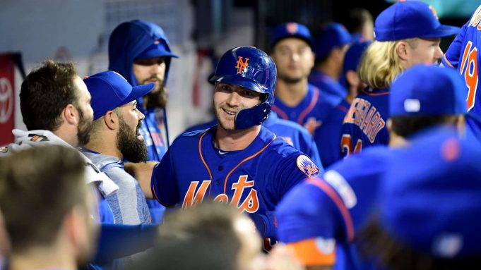 NEW YORK, NEW YORK - SEPTEMBER 27: Pete Alonso #20 of the New York Mets celebrates after hitting a home run in the first inning of their game against the Atlanta Braves, his 52nd home run of the season and tying Aaron Judge's rookie home run record, during their game at Citi Field on September 27, 2019 in the Flushing neighborhood of the Queens borough of New York City.
