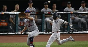 CLEVELAND, OHIO - JULY 09: Pete Alonso #20 of the New York Mets and Gleyber Torres #25 of the New York Yankees during the 2019 MLB All-Star Game at Progressive Field on July 09, 2019 in Cleveland, Ohio.