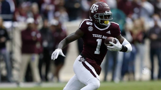 COLLEGE STATION, TEXAS - OCTOBER 26: Quartney Davis #1 of the Texas A&M Aggies looks for room to run against the Mississippi State Bulldogs at Kyle Field on October 26, 2019 in College Station, Texas.