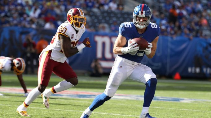 EAST RUTHERFORD, NEW JERSEY - SEPTEMBER 29: Rhett Ellison #85 of the New York Giants catches the ball against Landon Collins #20 of the Washington Redskins during their game at MetLife Stadium on September 29, 2019 in East Rutherford, New Jersey.
