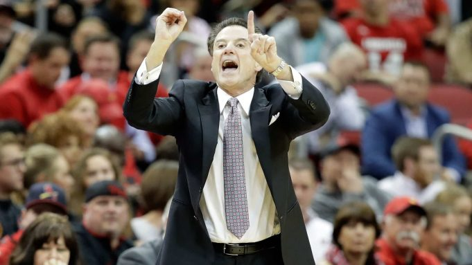 LOUISVILLE, KY - JANUARY 11: Rick Pitino the head coach of the Louisville Cardinals gives instructions to his team during the game against the Pittsburgh Panthers at KFC YUM! Center on January 11, 2017 in Louisville, Kentucky.