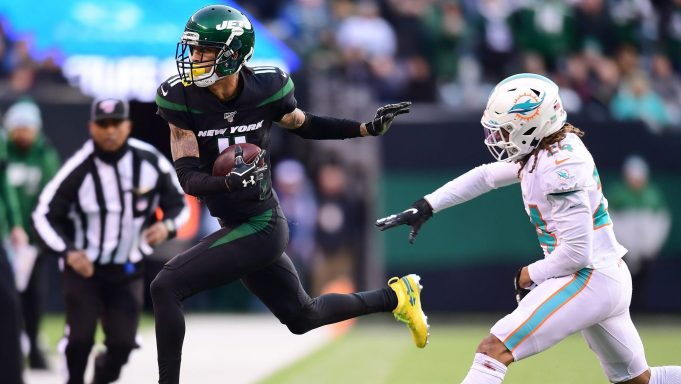 EAST RUTHERFORD, NEW JERSEY - DECEMBER 08: Robby Anderson #11 of the New York Jets is pushed out of bounds by Ryan Lewis #24 of the Miami Dolphins after completing a pass in the second half of their game at MetLife Stadium on December 08, 2019 in East Rutherford, New Jersey.