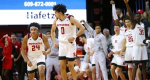 PISCATAWAY, NJ - JANUARY 09: Geo Baker #0 of the Rutgers Scarlet Knights reacts after scoring the game winning three-point basket defeating the Ohio State Buckeyes 64-61 in a game at Rutgers Athletic Center on January 9, 2019 in Piscataway, New Jersey.