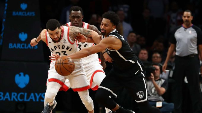 NEW YORK, NY - JANUARY 08: Fred VanVleet #23 of the Toronto Raptors and Spencer Dinwiddie #8 of the Brooklyn Nets battle for the ball during their game at Barclays Center on January 8, 2018 in New York City.