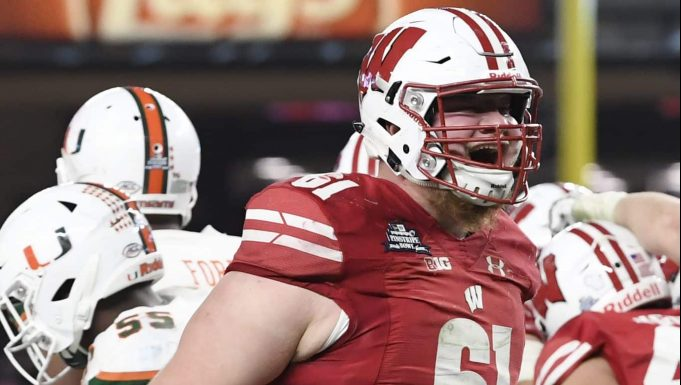 NEW YORK, NEW YORK - DECEMBER 27: Tyler Biadasz #61 of the Wisconsin Badgers reacts after the Badgers score a touchdown in the third quarter of the New Era Pinstripe Bowl against the Miami Hurricanes at Yankee Stadium on December 27, 2018 in the Bronx borough of New York City.