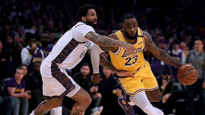 LOS ANGELES, CALIFORNIA - MARCH 10: LeBron James #23 of the Los Angeles Lakers drives to the basket past Wilson Chandler #21 of the Brooklyn Nets during a 104-102 Nets win at Staples Center on March 10, 2020 in Los Angeles, California.
