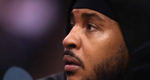 PHOENIX, ARIZONA - DECEMBER 16: Carmelo Anthony #00 of the Portland Trail Blazers sits on the bench during the first half of the NBA game against the Phoenix Suns at Talking Stick Resort Arena on December 16, 2019 in Phoenix, Arizona.